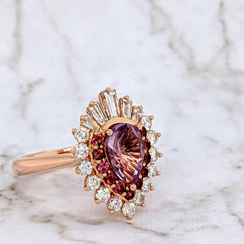 Custom Design: 18k Rose Gold with a pear cut Amethyst centre stone, pink tourmalines, and tapered baguette diamonds