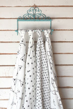 displayed Modern swaddle bundle of XOXO, milk jug, +plus and teepee designs