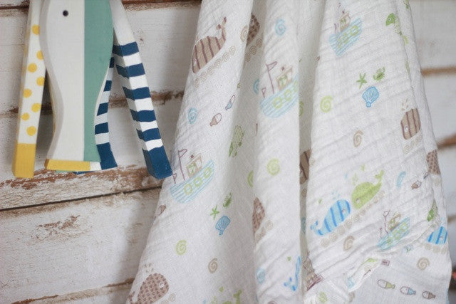 Seaside swaddle with fish decor