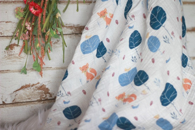 Fox pattern swaddle with decoratve flowers
