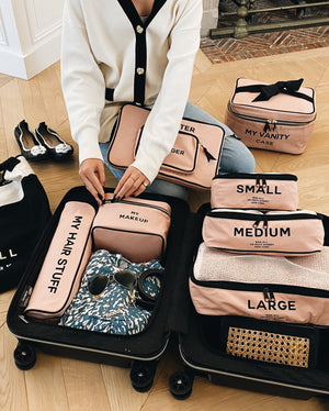 Organized suitcase with Pink blush Packing cubes, travel bags, organizing bags from Bag-all