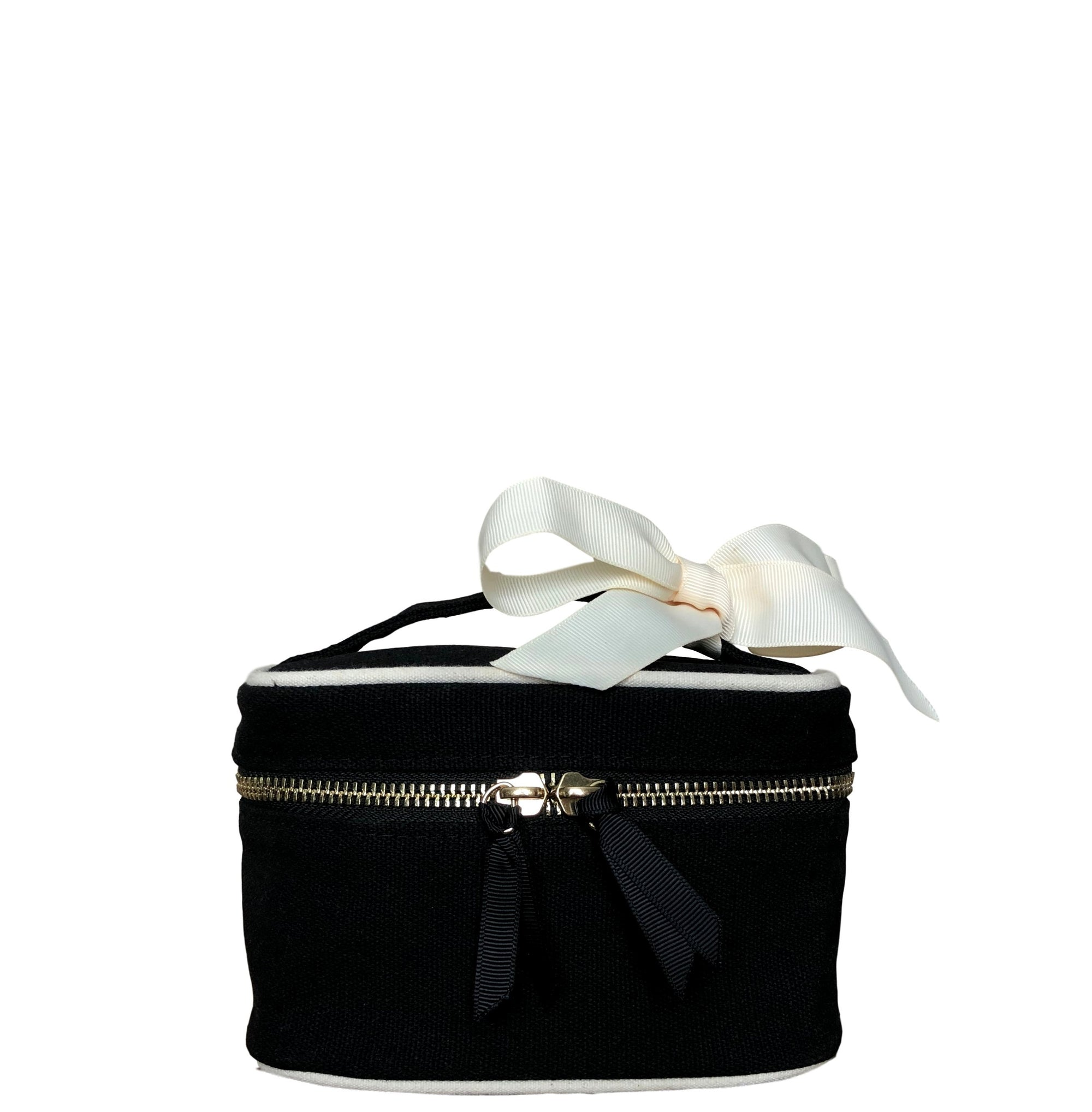 Mini beauty box in black with white details and a white bow attached to the handle.