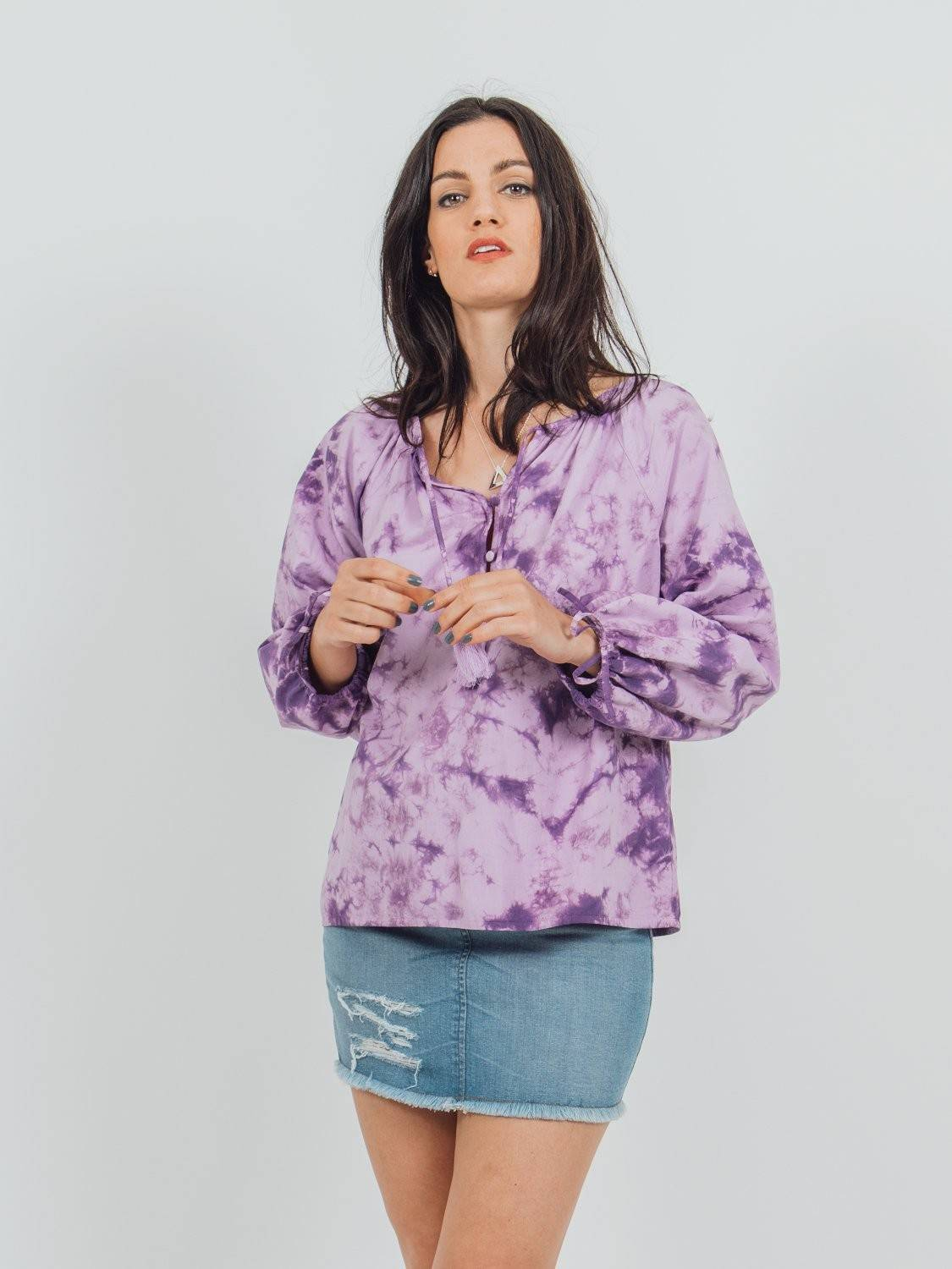 volumious purple tie-dye long-sleeved blouse with drawstring cuffs and round neck