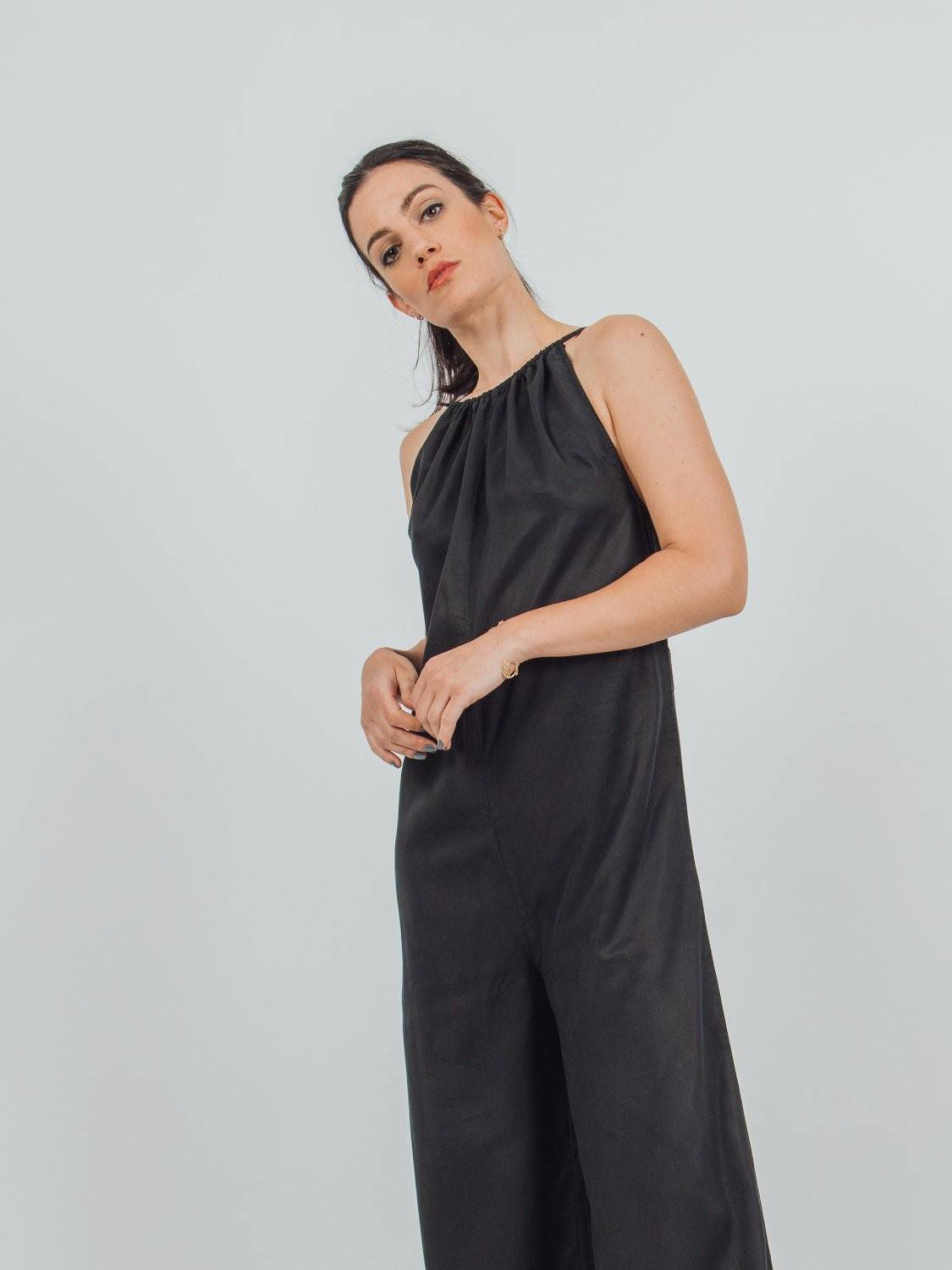 straight fit jumpsuit with wide gathered halter neck into a deep keyhole back and dropped sides in tencel