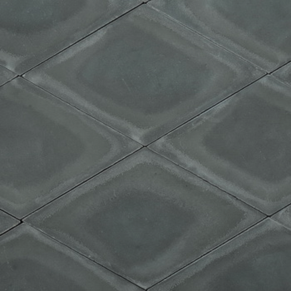 Diamond or rhomb shaped cement tile / encaustic tile in dark green for outdoor use, e.g. garden, patio or driveway