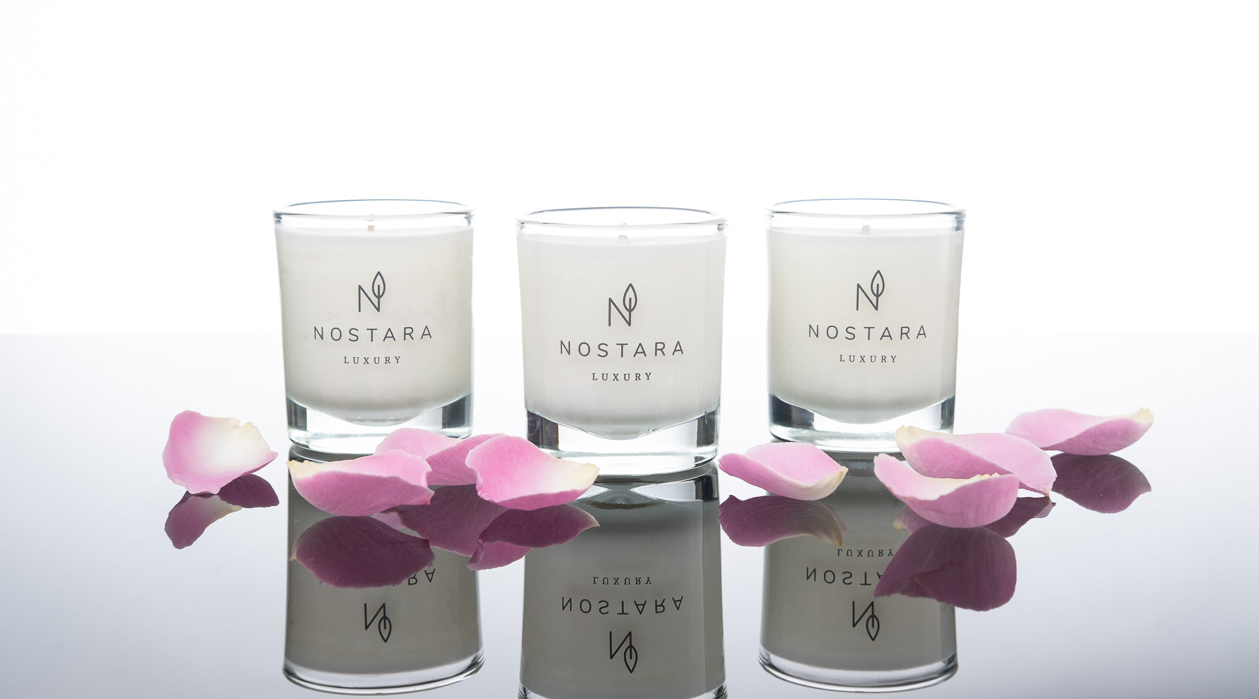 Nostara Home Fragrance Travel Candle Collection Image with Pink Petals