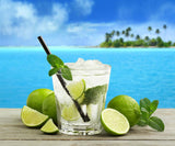 Nostara image of mojito by the beach with limes