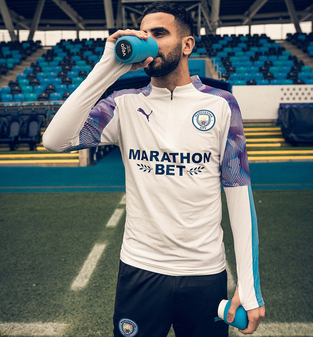 Riyad Mahrez sipping from his Cityzen Blue Vejo