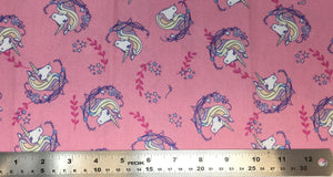 Group swatch cartoon unicorn head printed fabric in various colours