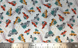 Flat swatch cartoon Christmas tree on vehicle printed fabric in orange (white fabric with tossed cartoon trucks with christmas trees in back in grey, yellow, red shades)