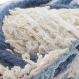 Scrub Off yarn swatch in shade denim (white and assorted faded blues)