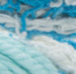 Scrub Off yarn swatch in shade spring blue (white, light and bright blues)