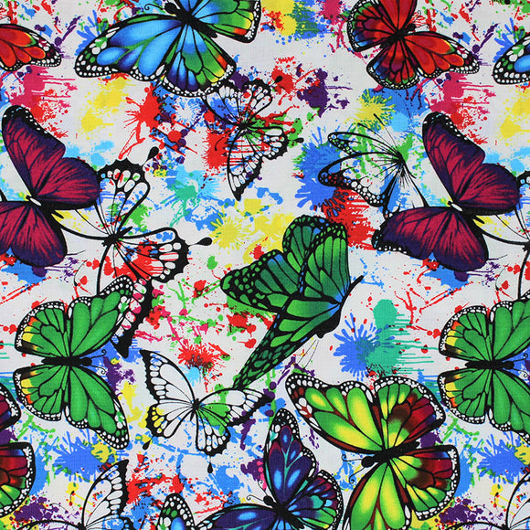 Square swatch butterflies in flight fabric (white fabric with blue, yellow, green, red, pink, purple pain splatters and drips allover with tossed black butterfly outlines and green, blue, purple, red butterflies in flight)