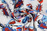Swirled swatch of cartoon superhero print pattern in blue