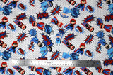 Flat swatch of cartoon superhero print pattern in blue