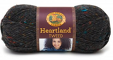 Ball of Lion Brand Heartland in colourway Black Canyon Tweed (heathered black with bright blue, red, orange, and gold flecks)