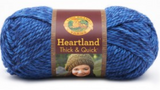 A ball of Lion Brand Heartland Thick & Quick in colourway Olympic (heathered royal blue)