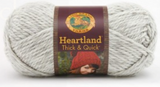 A ball of Lion Brand Heartland Thick & Quick in colourway Katmai (heathered light grey)