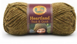 A ball of Lion Brand Heartland Thick & Quick in colourway Joshua Tree (heathered olive green)