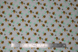 Flat swatch grey bee fabric (pale grey fabric with cartoon yellow and black bees with pale teal wings tossed allover)