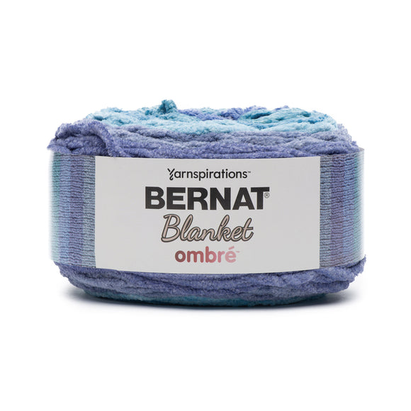 A cake of Bernat Blanket Ombre in colourway Shaded Blue (shades of blue with a bit of turquoise)