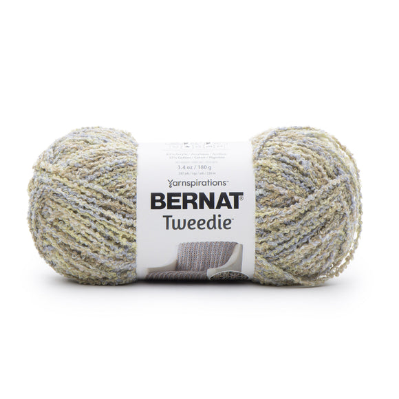 A ball of Bernat Tweedie yarn in shade summer rain (white/pale yellow/tan colourway with tweed like texture)