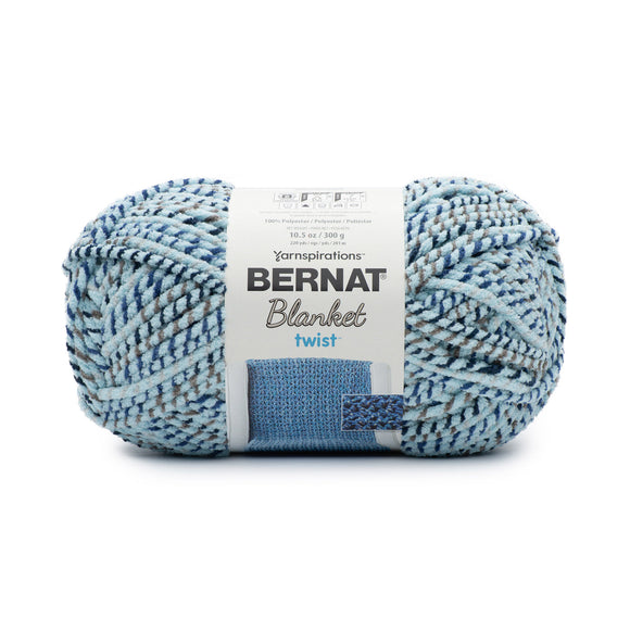 A ball of Bernat Blanket Twist in colourway Sea and Stars (soft turquoise twisted with grey and navy)