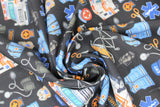 "Swirled swatch paramedic black fabric (black fabric with small tossed full colour paramedic themed emblems: orange stretchers, blue vests and hats, ""EMT/EMS"" badges and text, blood pressure cuffs, scissors, etc.)"