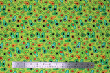 Flat swatch printed fabric from the Chili Smiles line in sprout (bright green fabric with tossed cartoon happy avocado halves in various green shades)