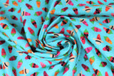 Swirled swatch printed fabric from the Chili Smiles line in aqua (bright light blue/aqua fabric with tossed cartoon happy chilis in various styles including sunglasses, beige/black sun hat, open mouths, etc.)