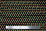 Flat swatch printed fabric from the Chili Smiles line in black rainbows (black fabric with small tiled colourful rainbow arches)