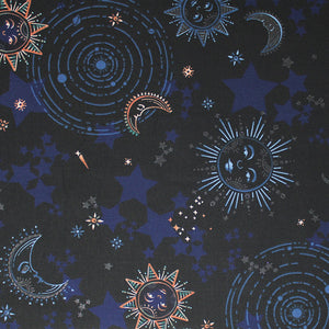 Square swatch moonlight fabric (black fabric with tossed decorative suns and moons, circular solar systems, blue stars)