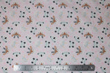 Flat swatch cartoon animals with flower crowns printed fabric on pale pink (deer, bears, bunny)