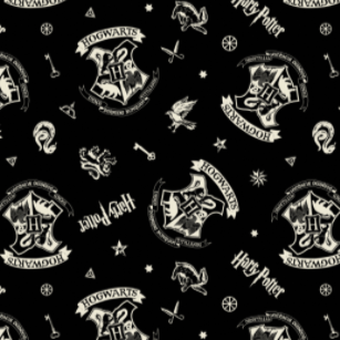Swatch of Harry Potter themed quilting cotton fabric.  White Hogwarts crests, keys, stars, and