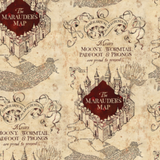 "Swatch of Harry Potter themed quilting cotton fabric.  Alternating motifs in offset rows over a parchment coloured and textured background.  One motif is a line drawing of four walls enclosing a square, which is filled with deep red and the words ""The Marauder's Map"". Tightly written latin text in a large abstract blob below. The other motif features an ornately curled banner reading ""Itinerarium Maraudentium"", over the words ""Messrs. MOONY, WORMTAIL, PADFOOT & PRONGS are proud to present""."