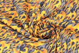 Swirled swatch fire alarm fabric (black fabric with orange/yellow flames layered over grey flames)