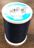 A spool of Coats & Clark Dual Duty All Purpose thread in Navy