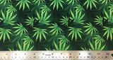 Flat swatch layered pot leaf print fabric in green