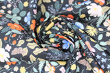 Swirled swatch Strawberry Fields collection floral printed fabric in black meadow (multi-coloured floral and strawberries on black)