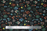 Flat swatch Strawberry Fields collection floral printed fabric in pressed floral (small multi-coloured floral bunches on black)