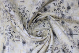 "Swirled swatch fabric dragonfly & bee white (white fabric with black and grey bees and dragonflies tossed, ""15"" text and faded notes looking square shapes with faint writing)"