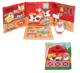 On the Farm - cover features a barn with pocket printed to look like fencing, and removable soft animal shapes tucked into the pocket. Book is opened to create a red barn scene, with a left flap, right flap and bottom flap all extending from back piece.