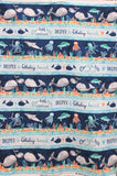 "Full swatch whale themed fabric in Whaley Loved Panel 23""x44"" (multi blue stripes, whales, and ""whaley loved"" text)"
