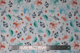 Flat swatch whale themed fabric in Sea Life White (assorted cartoon sea creatures on white)