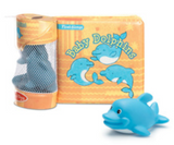 Baby Dolphins book made of pillowed vinyl pages with a mesh tube attached to the spine. The tube contains a few blue toy dolphins and the book cover features three cartoon dolpins on an orange and yellow background.