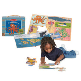 Deep Blue Sea book and puzzle contents on white background with image of young child playing with puzzle