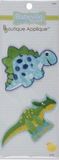 2 Dinosaur appliques - cartoon light blue stegosaurus with dark blue spots and green back plates; mid green triceratops with yellow spots and belly standing over the words Mr Handsome in yellow on blue background