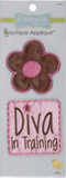 2 Fun Flowers/Diva appliques - cut-out brown 5 petal flower with pink centre and pink outline; square applique with the phrase Diva in Training in brown on pink background with a small flower dotting the 'i' in Diva