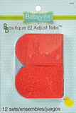 Package of 12 sets of Primary Colours Babyville Boutique EZ Adjust Tabs.  Two red tabs are visible, slightly longer than they are wide, with a rounded end on the left and squared end on the right.  The top tab is the hook side of the velcro pair, the lower tab is the loop side.  A hint of blue tab is barely visible below the red.