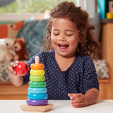 Child playing with Rainbow Stacker toy